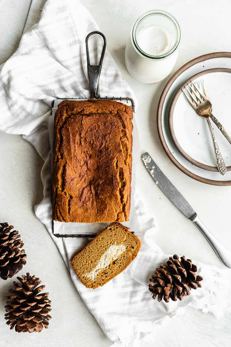 Healthy Pumpkin Bread - The Fit Peach   Extra fluffy pumpkin bread loaded with a vegan cream cheese filling — it's the ultimate fall baked good with a healthy twist! Made with natural ingredients like almond flour, REAL pumpkin, coconut milk, and more, it's full of cozy flavors and super simple to whip up.