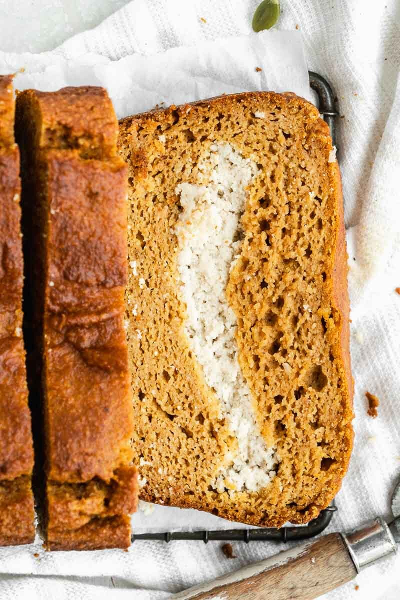 Gluten-free Healthy Pumpkin Bread - The Fit Peach  Extra fluffy pumpkin bread loaded with a vegan cream cheese filling — it's the ultimate fall baked good with a healthy twist! Made with natural ingredients like almond flour, REAL pumpkin, coconut milk, and more, it's full of cozy flavors and super simple to whip up.