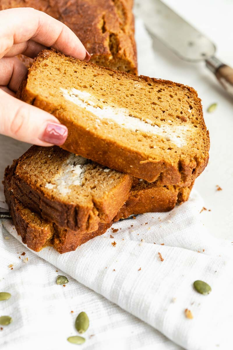Healthy Paleo Pumpkin Bread - The Fit Peach   Extra fluffy pumpkin bread loaded with a vegan cream cheese filling — it's the ultimate fall baked good with a healthy twist! Made with natural ingredients like almond flour, REAL pumpkin, coconut milk, and more, it's full of cozy flavors and super simple to whip up.