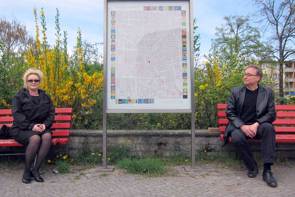 """Renata Stih and Frieder Schnock with a map of their """"Places of Remembrance"""" project, Schöneberg, Berlin, 2013."""