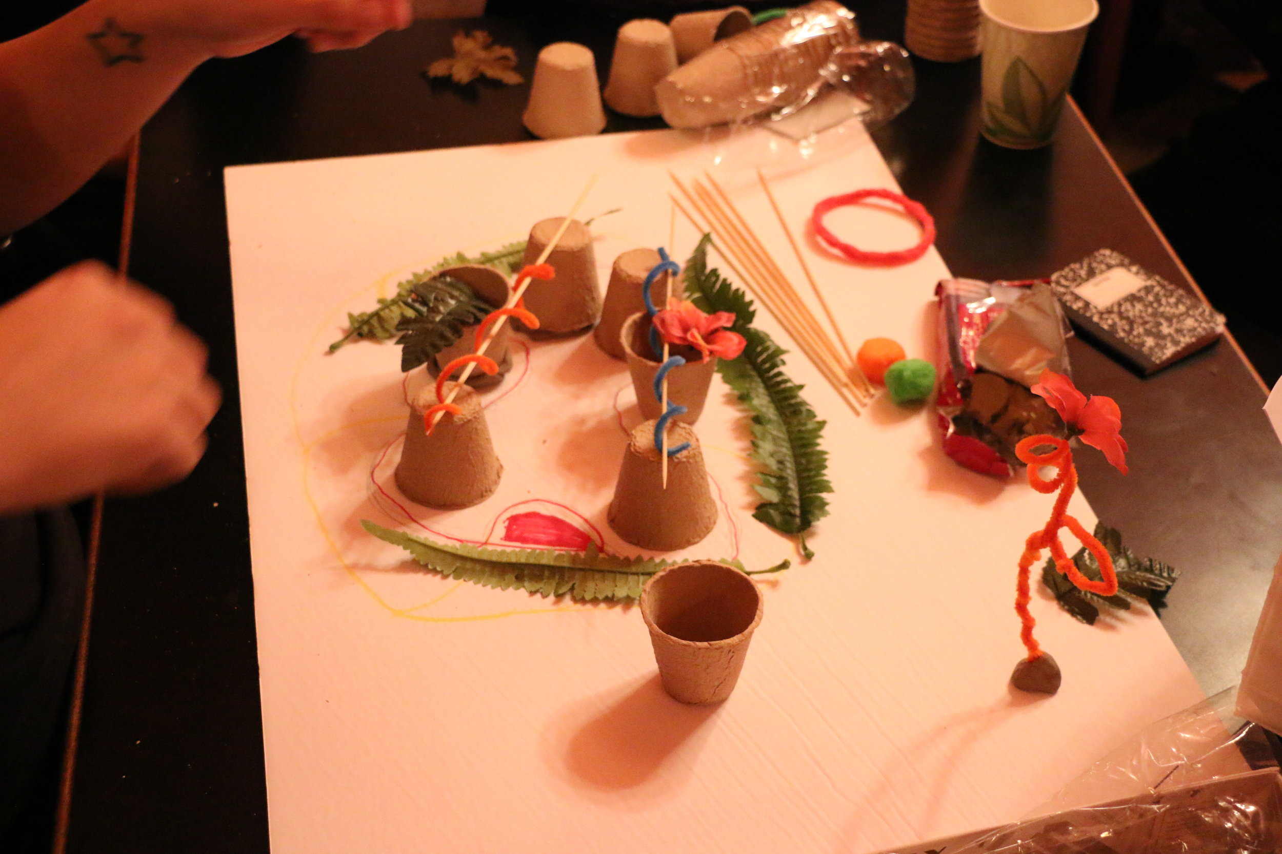 Participants take part in a craft-based warm up exercise to create models of imaginary spaces. Photo: Glenn Knockwood.