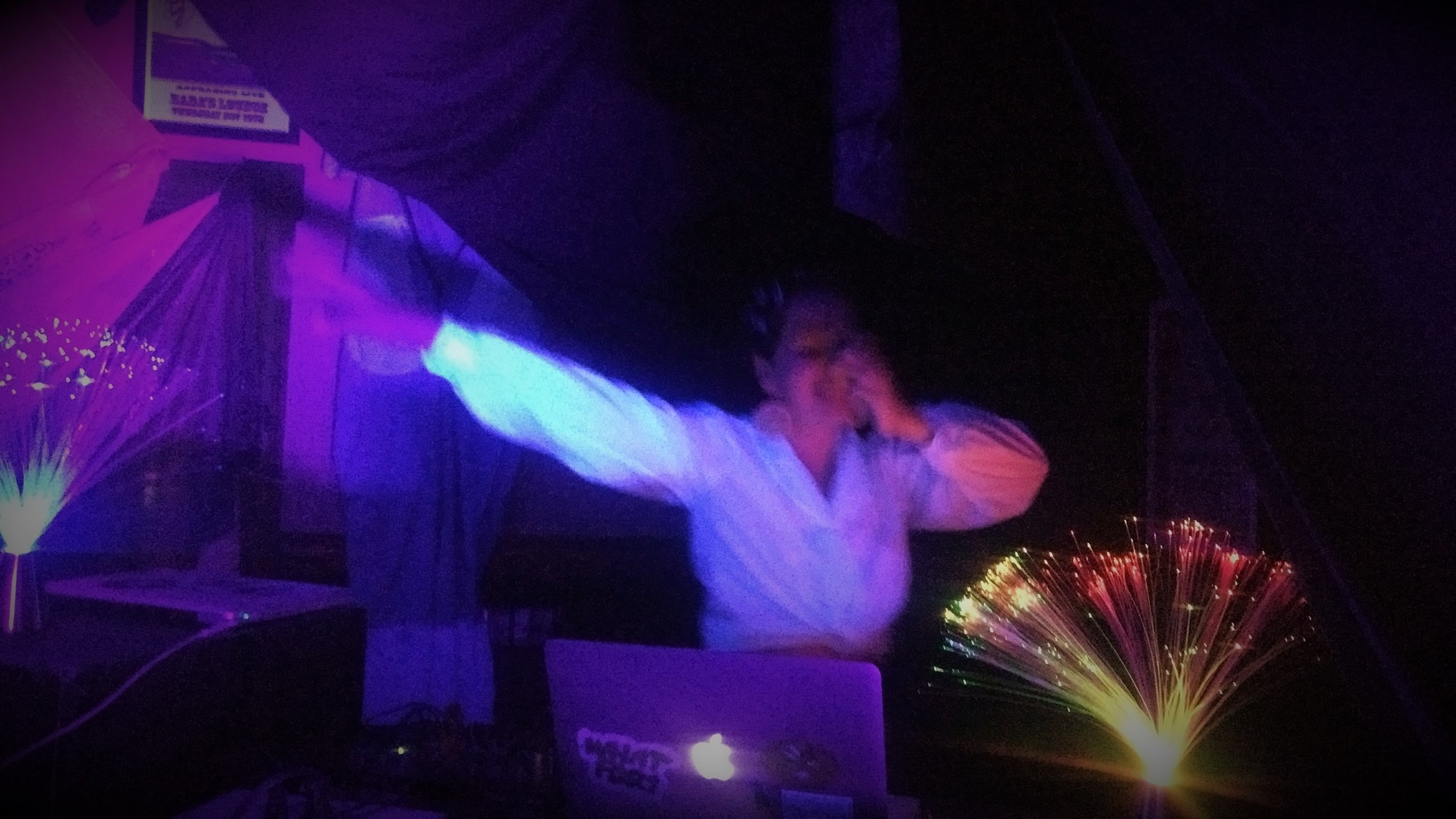 Lil Arepa's DJ set at GLAM Cave, coordinated by Russell Louder at Flotilla.