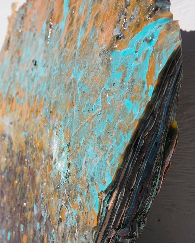 This is a chunk of the floor from Aquatech. The last dirt parking lot in Venice. In the shadow there are layers and layers of different colored resin.