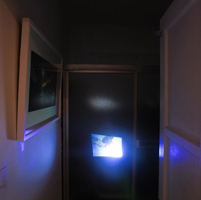 Video projection through the shower door by Ryan Thomas. The video is of Richard Kenvin surfing northern Malibu finless. The image on the left is of a 1970 fire by what is now Duke's.  @_ryan_thomas @hydrodynamica