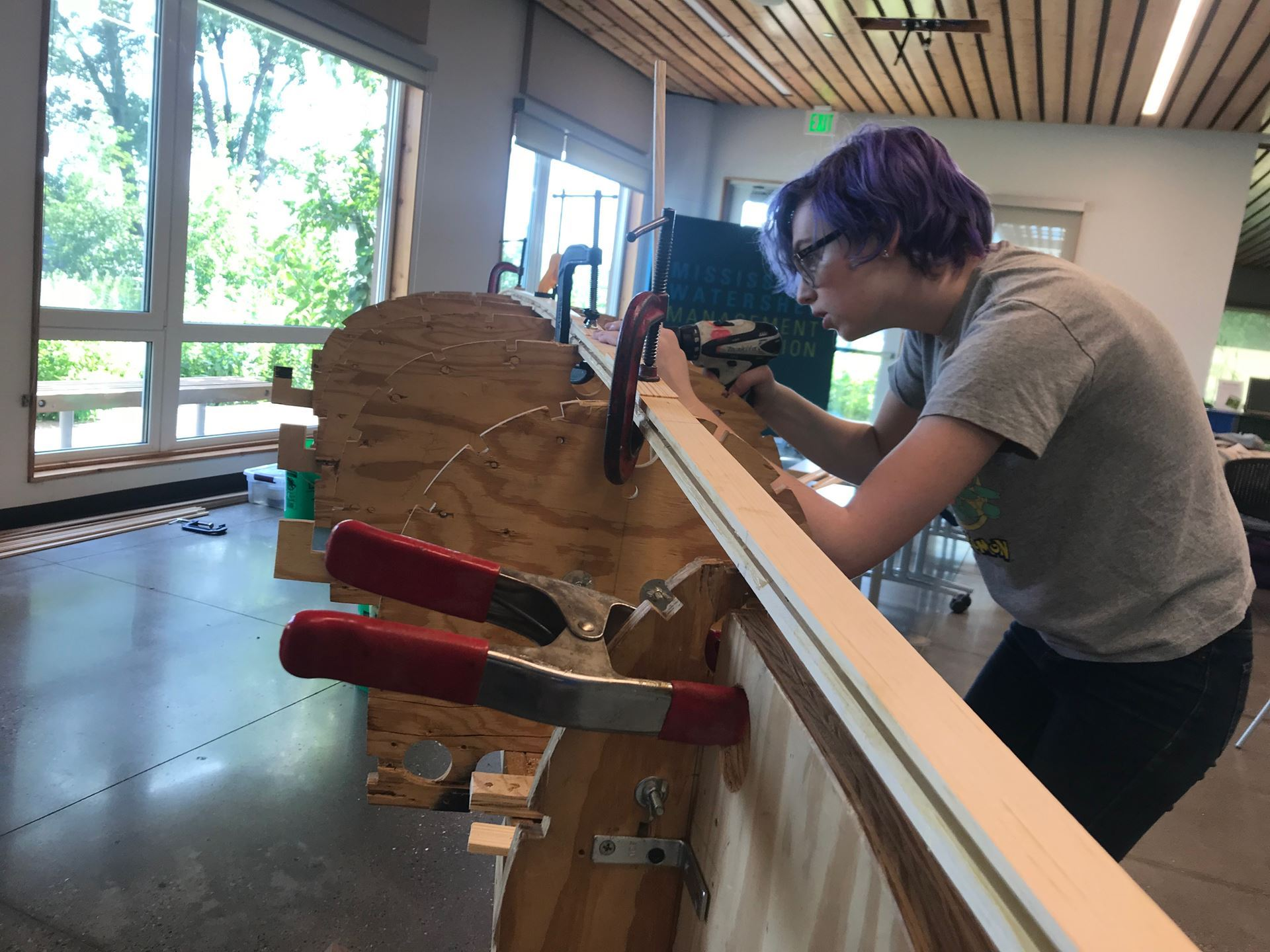 Photo of Menlo VIBE youth working on constructing a canoe.