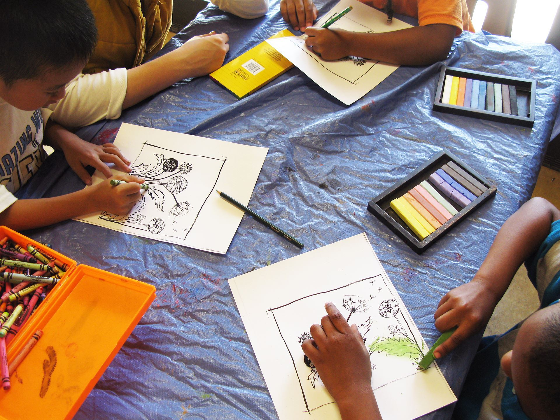 Photo of youth coloring with pastels.