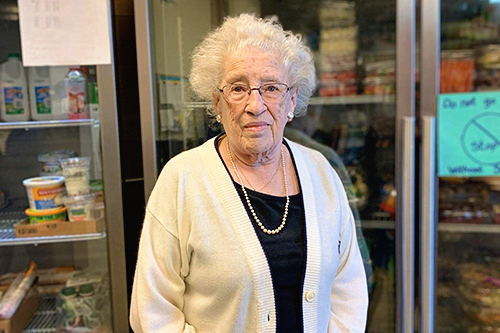 """- Learning TogetherDelores Vitterno, age 90, started volunteering with East Side 12 years ago in the Senior Dining Program, and now volunteers at the Senior Food Shelf. Community volunteers like Delores help make ESNS a welcoming space.""""I meet a lot of people: different races, different speeches. I get acquainted with a lot of people here because this is a big building. There are a lot of people, you would be surprised how friendly they are and I get along with them.""""- Delores, community volunteer"""