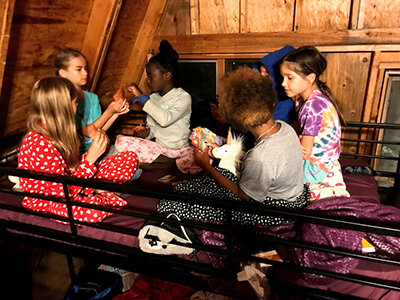 Group of campers playing a game in their cabin