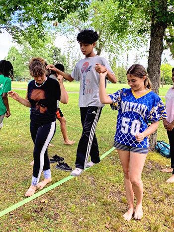 Campers trying a slackline