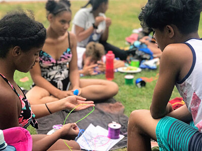 Campers doing crafts outdoors