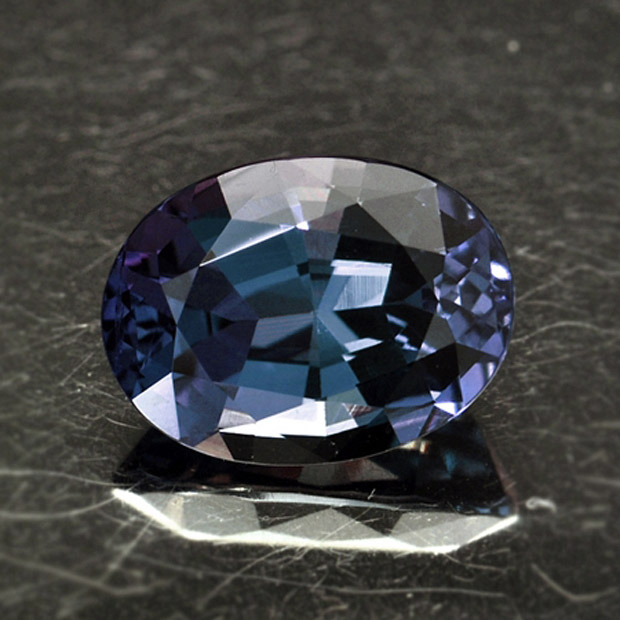 ALEXANDRITE - Alexandrite is a rare variety of the mineral Chrysoberyl. In outdoor light it looks bluish green, and in indoor light it has a more purplish-red color.Mohs Scale Rating: 8.5-9