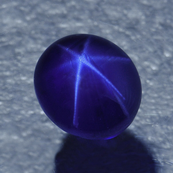 STAR SAPPHIRE - Star Sapphires are Sapphires that are heavily included with rutile, causing a star-like reflection that is most visible when the stone is cut in a cabochon shape.