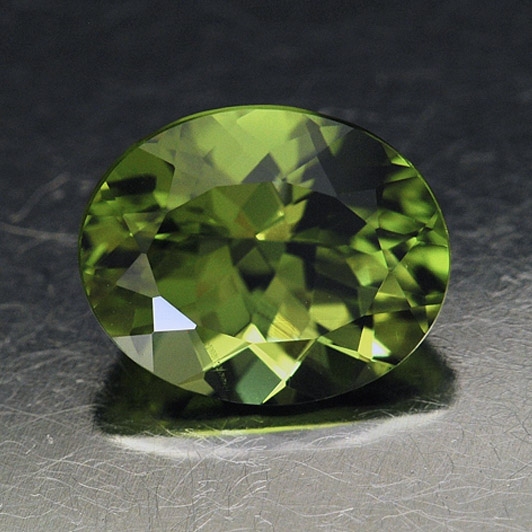 PERIDOT - Peridot is a lime-green colored stone.Mohs Scale Rating: 6.5-7