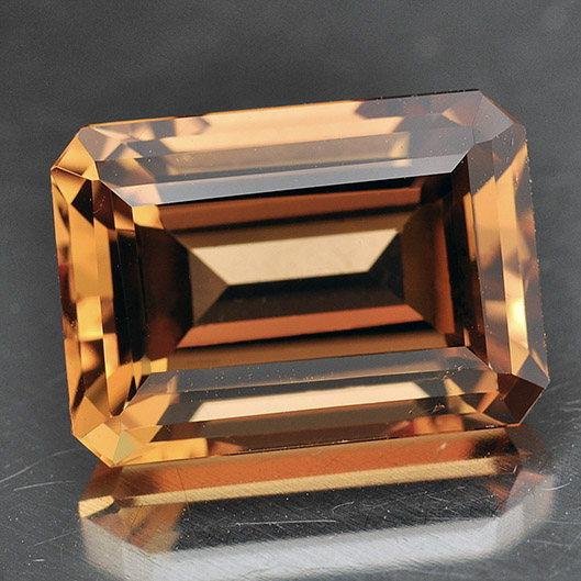 TOPAZ - Topaz is a gemstone that ranges in color from gold to pink to orange to brown. It has a hardness of 8 on the Mohs scale.