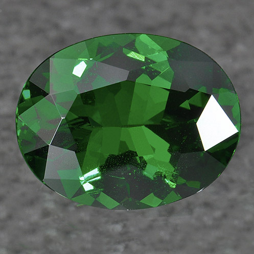 TSAVORITE - Tsavorite is another member of the Garnet family, and it has a transparent and usually intense green color. It has a hardness of 7-7.5 on the Mohs scale.