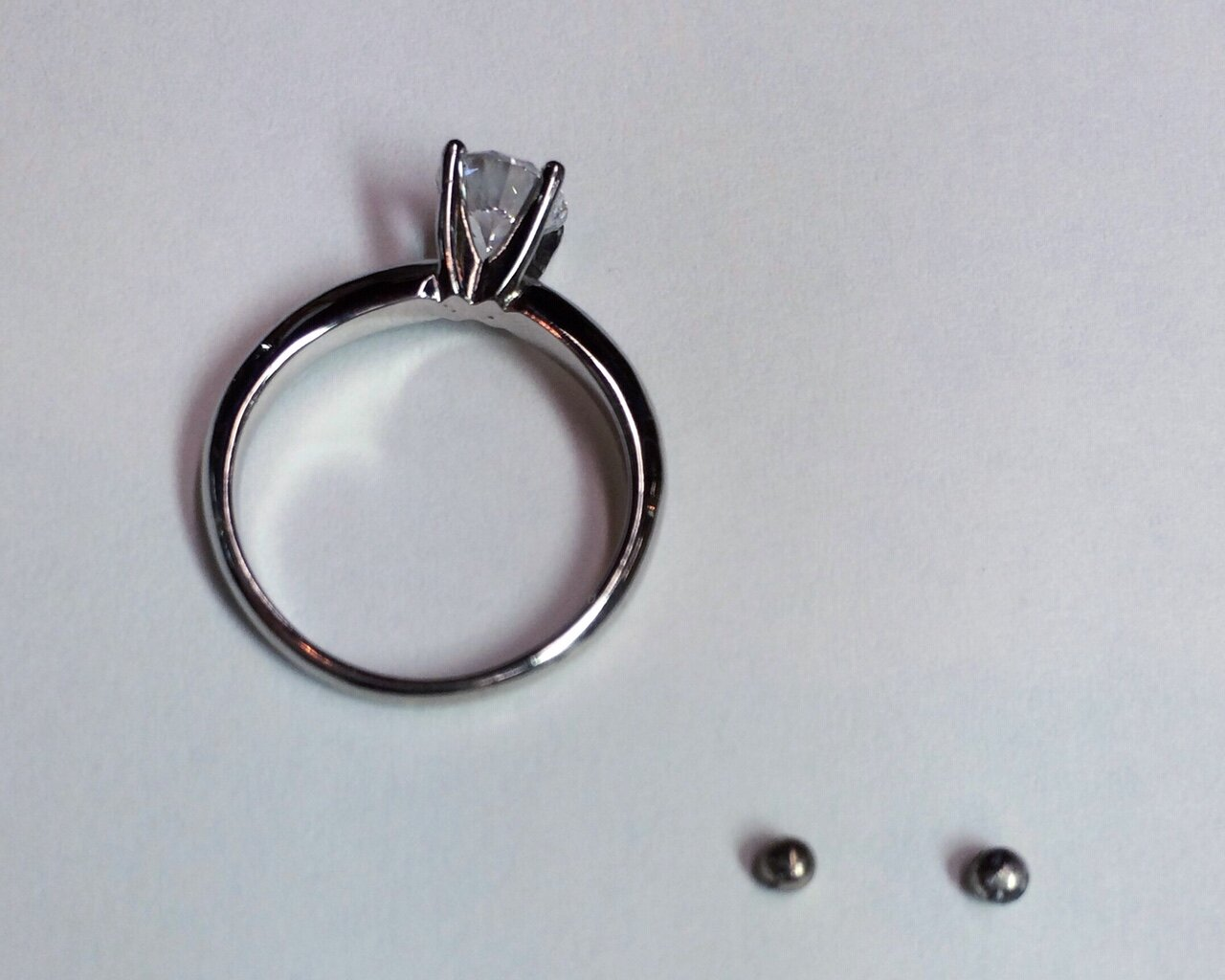 We are adding sizing balls to this classic solitaire setting.