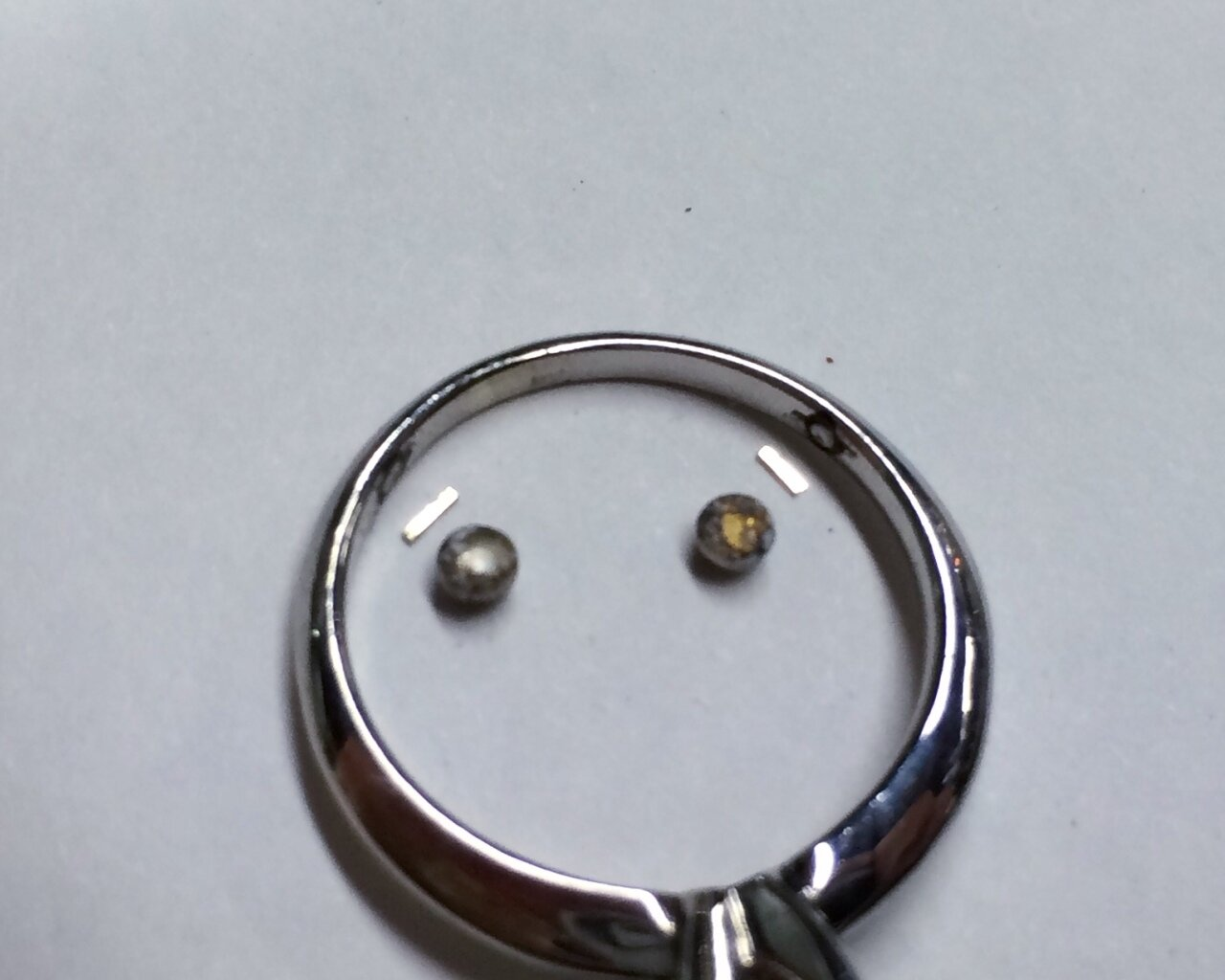 Next to the sizing balls are small strips of solder that will be heated in order to attach the balls to the ring.
