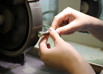 Polishing - Polishing is key to encouraging a gemstone's optimal lustre to shine through the cut stone. Holts Lapidary services include polishing, to achieve a smooth surface that enhances the unique colour and characteristics of the stone.
