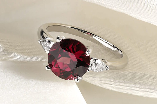 Ruby - Ruby gemstones are a variation of sapphire, and are equally a suitable choice for a wearable, durable and charming engagement ring. With a long history of representing enduring love and passion, the intense crimson tones of the gemstone are the perfect gesture for a meaningful engagement ring. Discover ruby engagement ring styles, how to choose the perfect ruby and whether the gemstone is the right choice for you.Ruby Engagement Rings