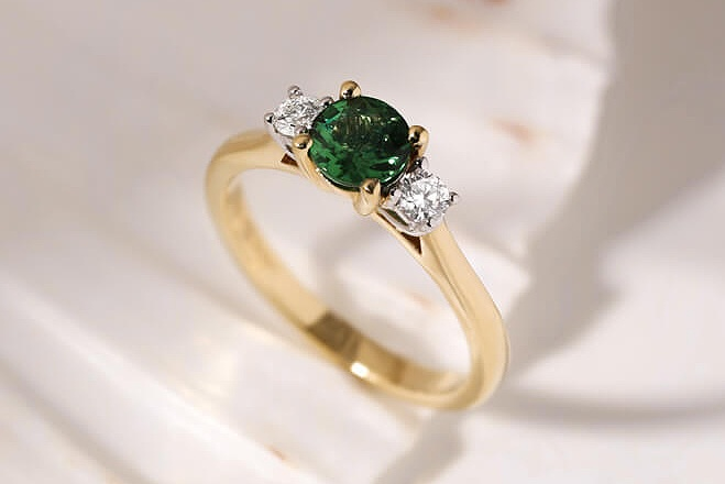 Emeralds - Emeralds are distinct, verdant green gemstones, and are a more unusual choice for gemstone engagement rings. Emeralds are a little softer than sapphires and rubies, ranking 7.5-8 on the Mohs scale, yet their lush and exotic appeal give them a notable charm, ideal for a unique engagement ring. Explore emerald engagement rings designs we love, learn more about the origins of the gemstone and discover how to choose the most ideal emerald for your engagement ring.Emerald Engagement Rings