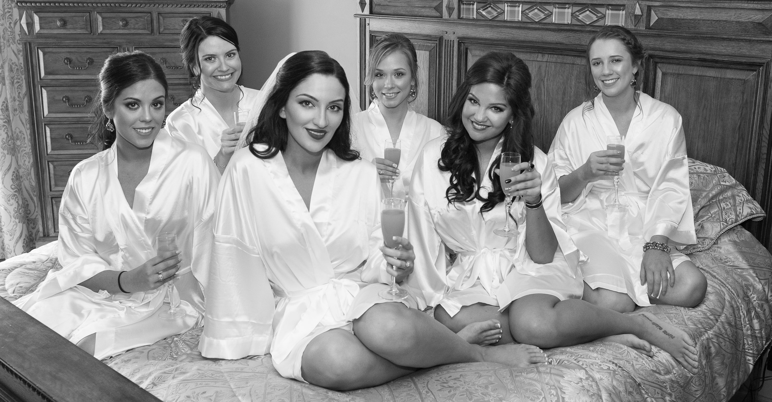 Bride-and-Bridesmaids-on-bed-portrait-2.jpg