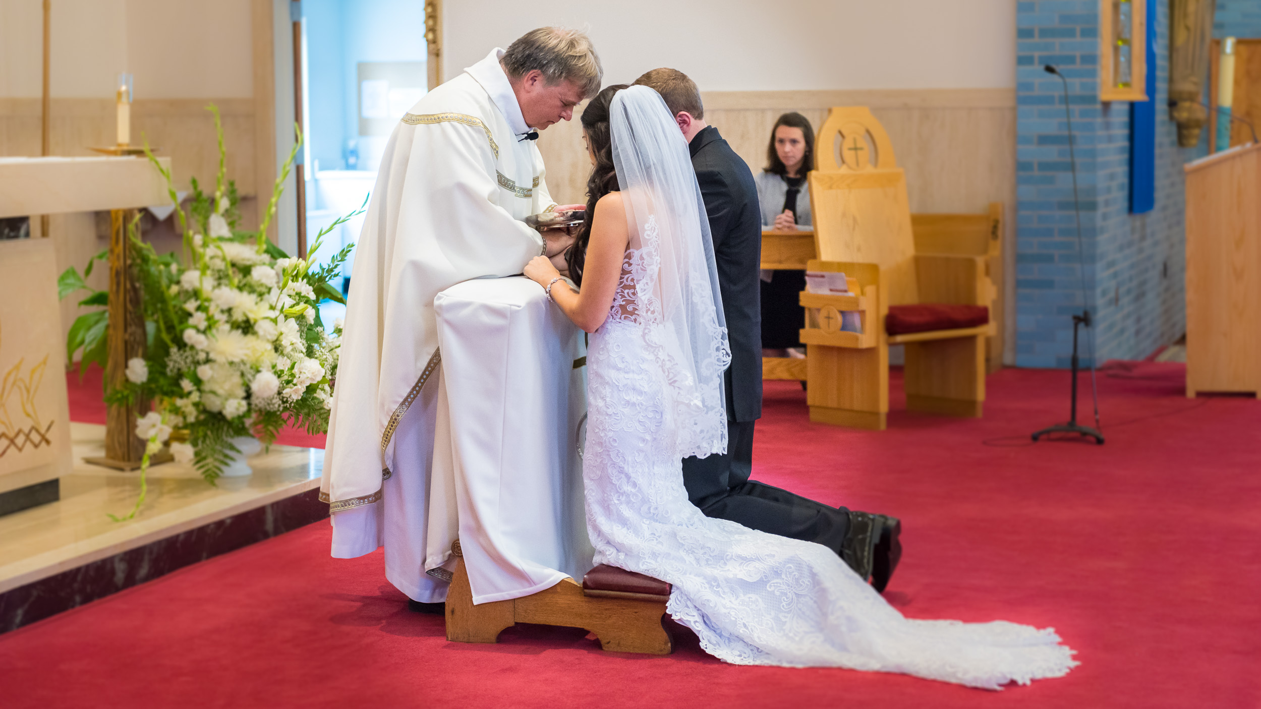 Wedding-ceremony-bride-and-groom-with-priest-1.jpg