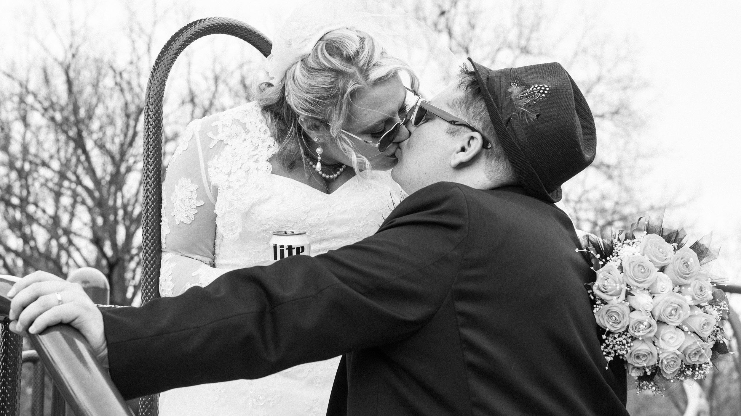 Bride-and-Groom-on-Playground-kissing-4.jpg