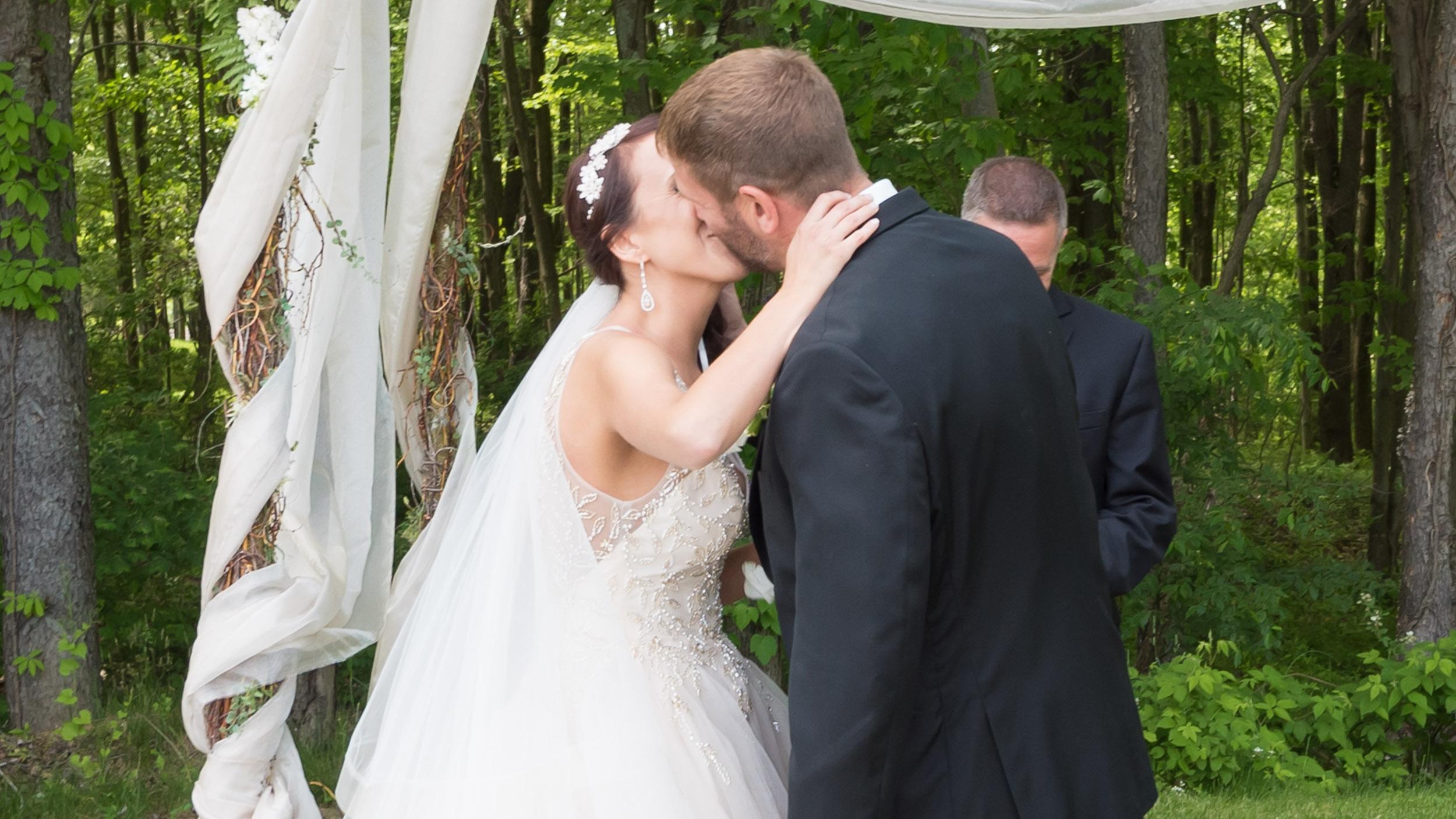 Bride-and-groom-first-kiss-outdoor-wedding.jpg