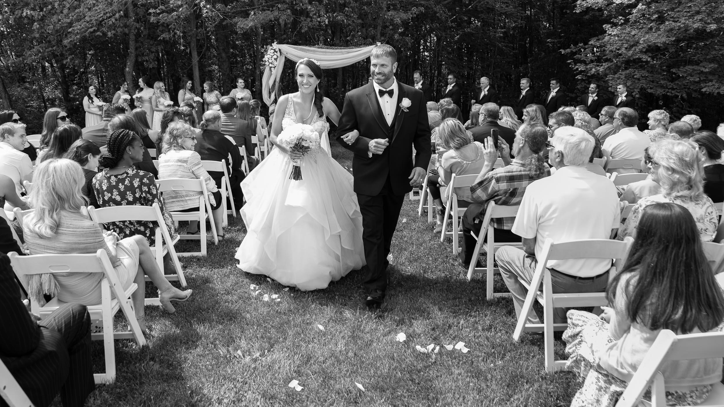 Bride-and-groom-walking-down-the-aisle.jpg