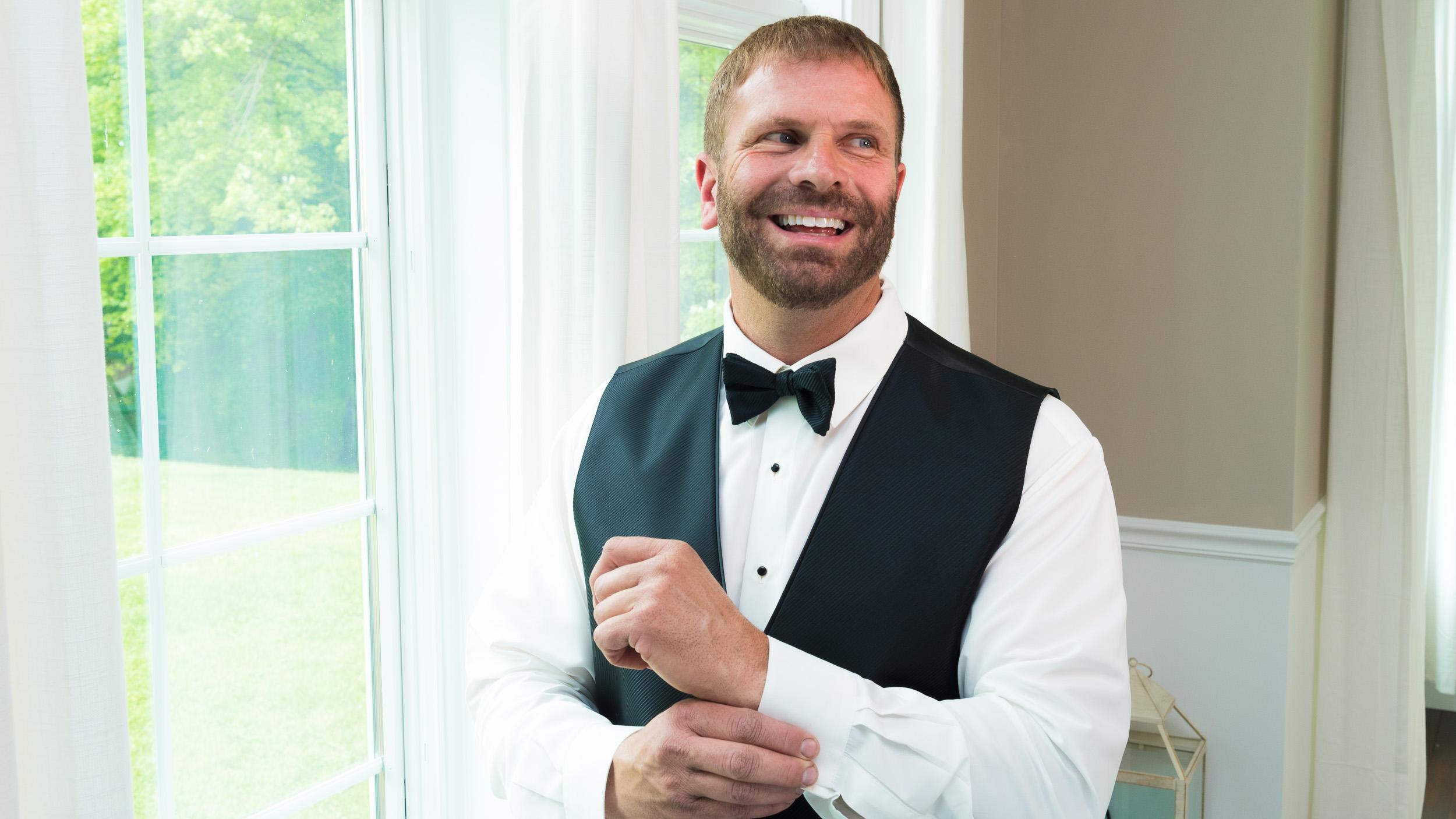 groom-getting-ready-by-window.jpg