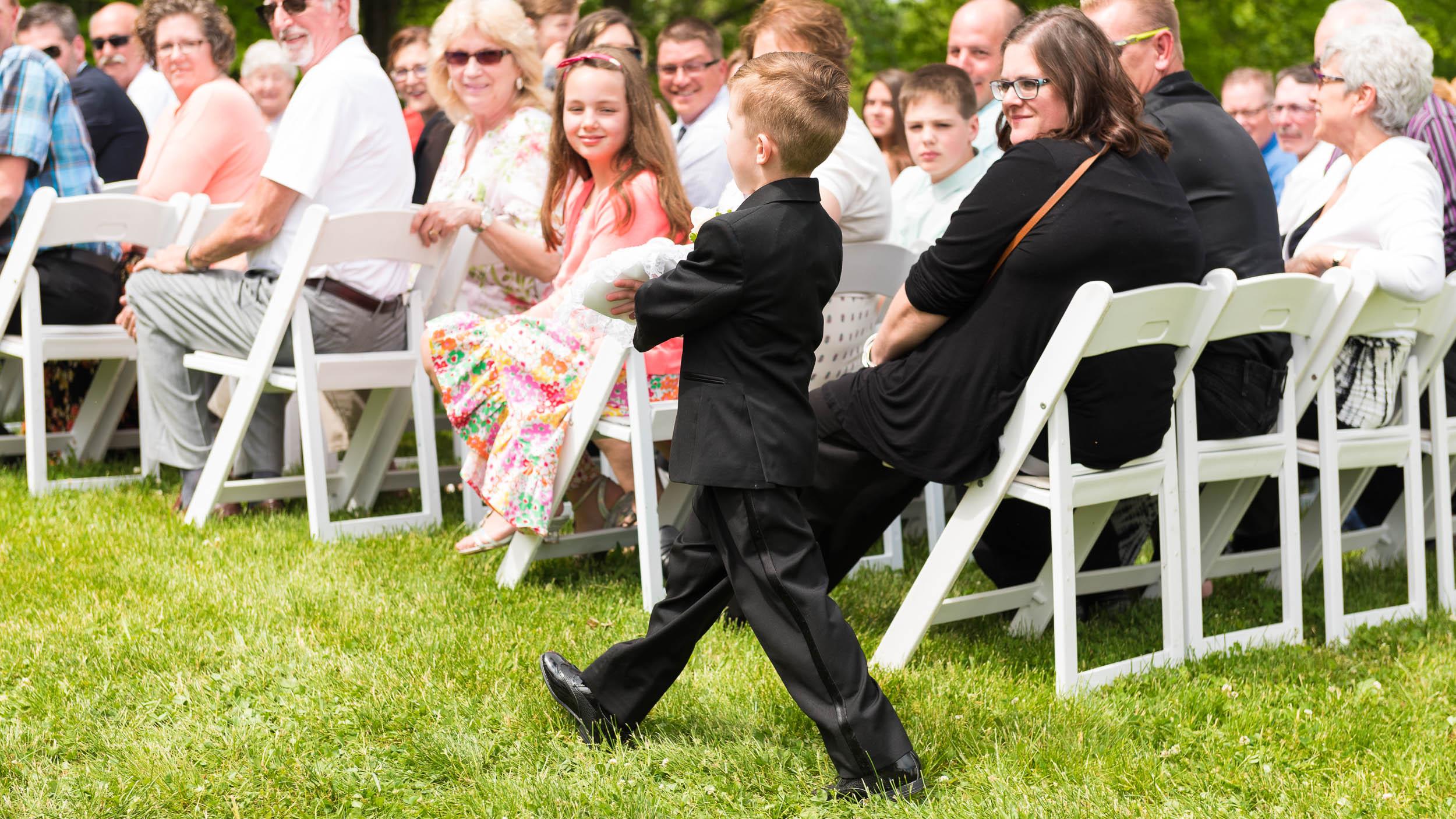 Ring-bearer-Wedding-outdoor-ceremony.jpg