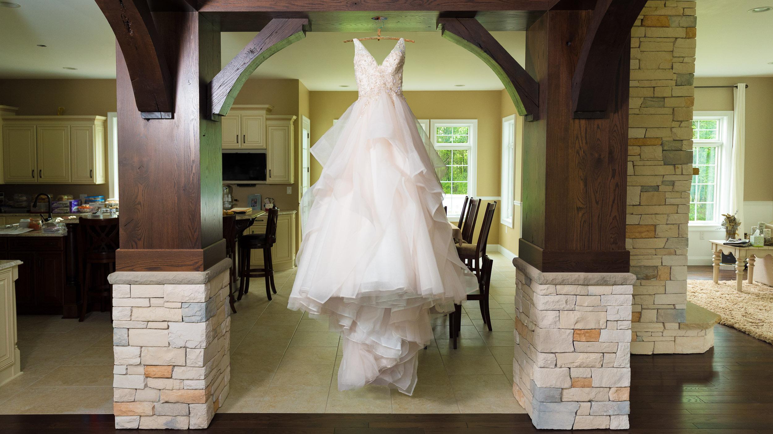 Wedding-dress-hanging-in-hallway.jpg