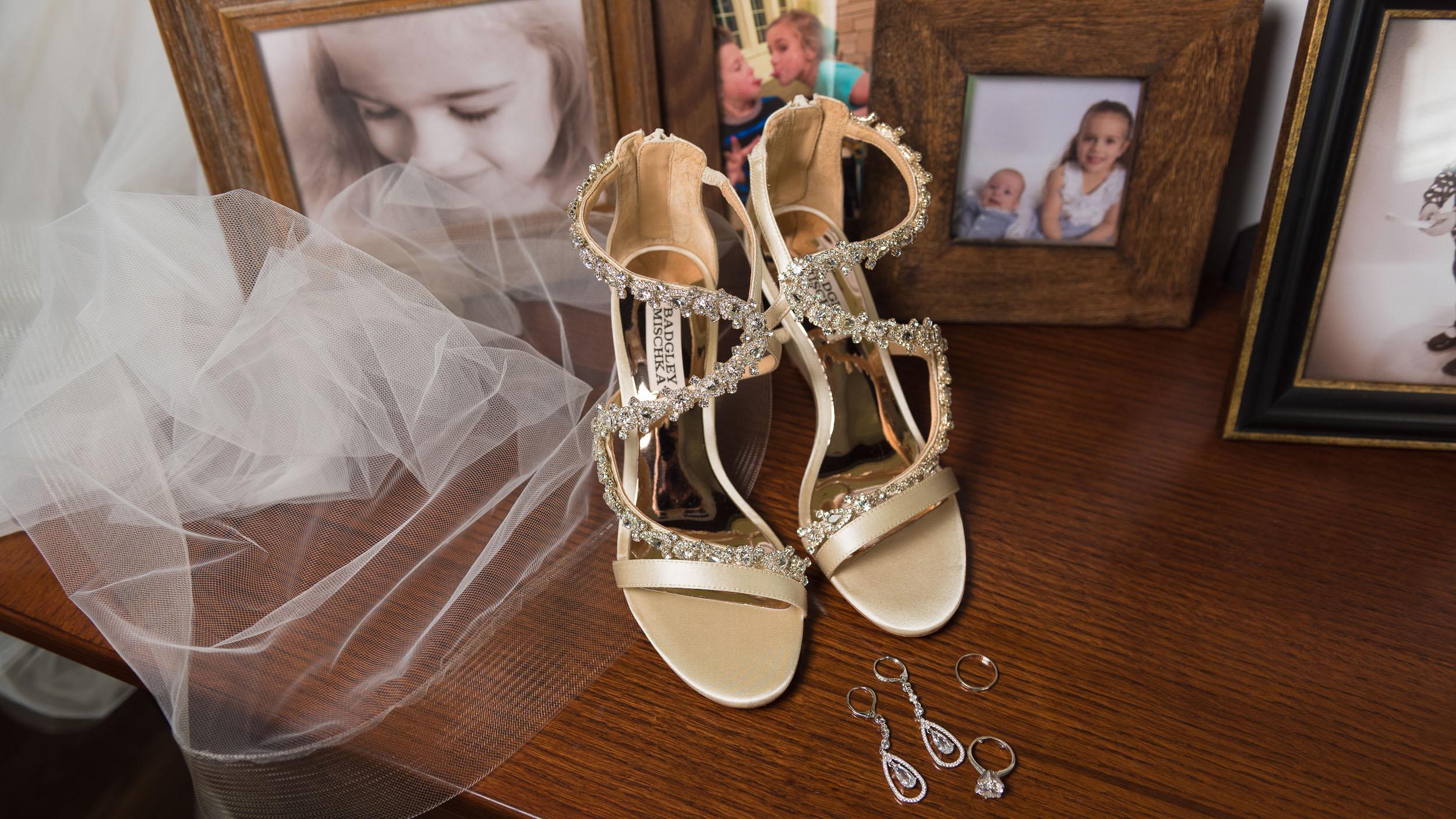 wedding-veil-and-shoes-with-framed-photos.jpg
