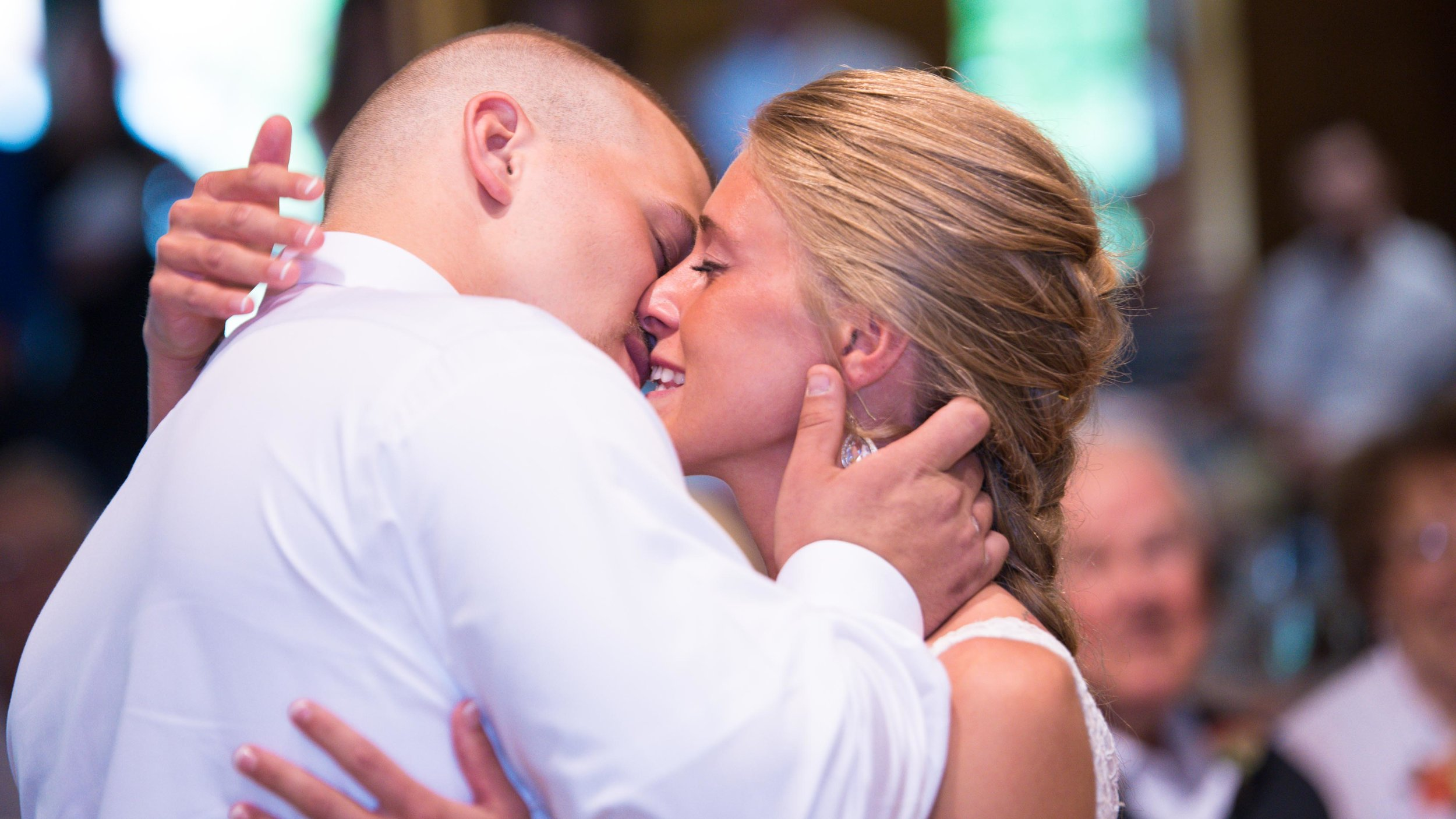 Bride-and-groom-first-kiss-mayernik-center-1.jpg