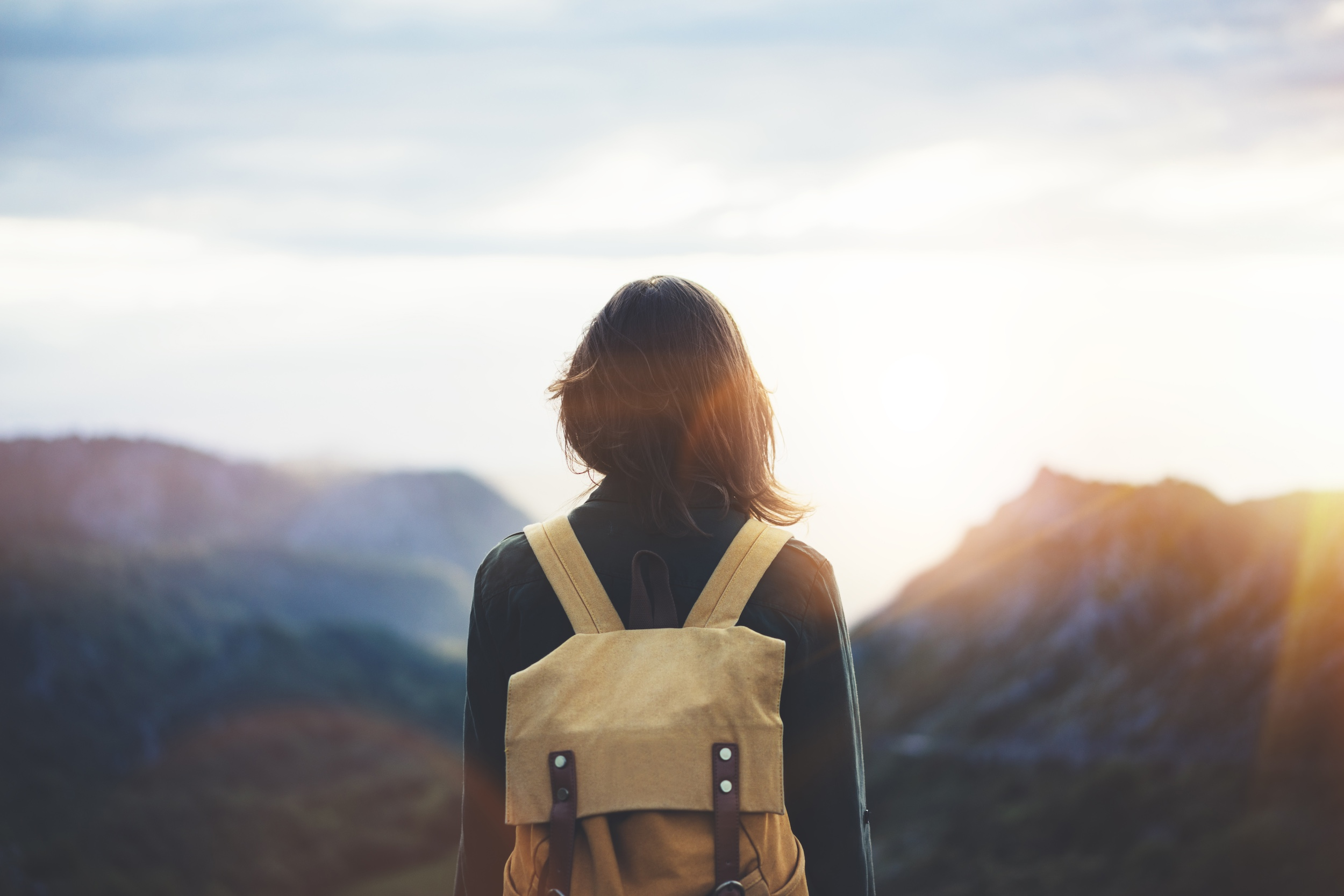 Girl with backpack with a view of the mountains.jpg