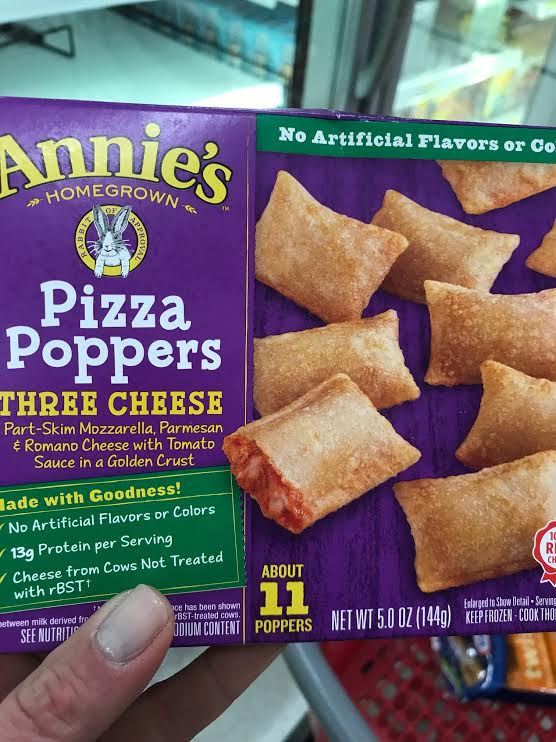 Annie's Pizza Poppers - 3.5*. These were definitely a more lukewarm liking by the kids than the Amy's. Some pluses - No artificial flavors or colors, cheese from cows not treated with rBST, lower in sodium and fat than many other frozen pizzas, quick to make. Negatives - don't love the last few ingredients - soy flour and cellulose powder (to be fair they are in small quantities since they are at the end of the ingredient list); expensive for a tiny amount of food; the ingredients I would like to see organic (tomatoes and much of the cheese) are not. For the price, I would sooner buy a slice of pizza made with real ingredients and cut it up into small pieces for your child.