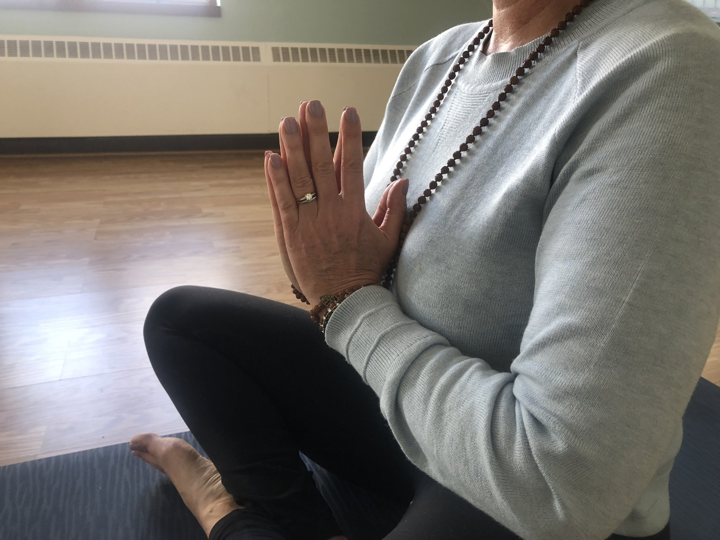 Lisa Sitting with Hands - Pure Yoga Fitness.jpg