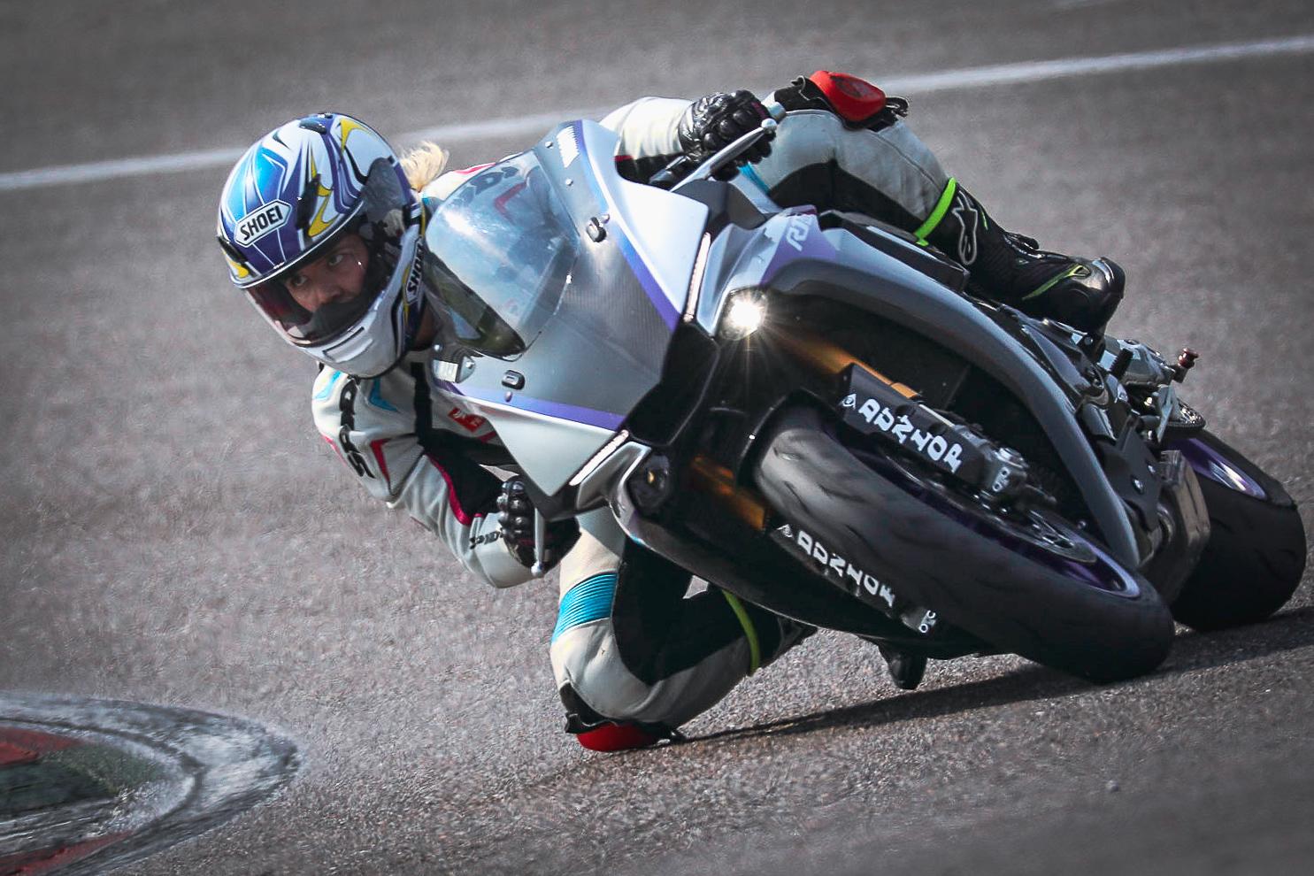 Woman on a motorcycle bella litinetski