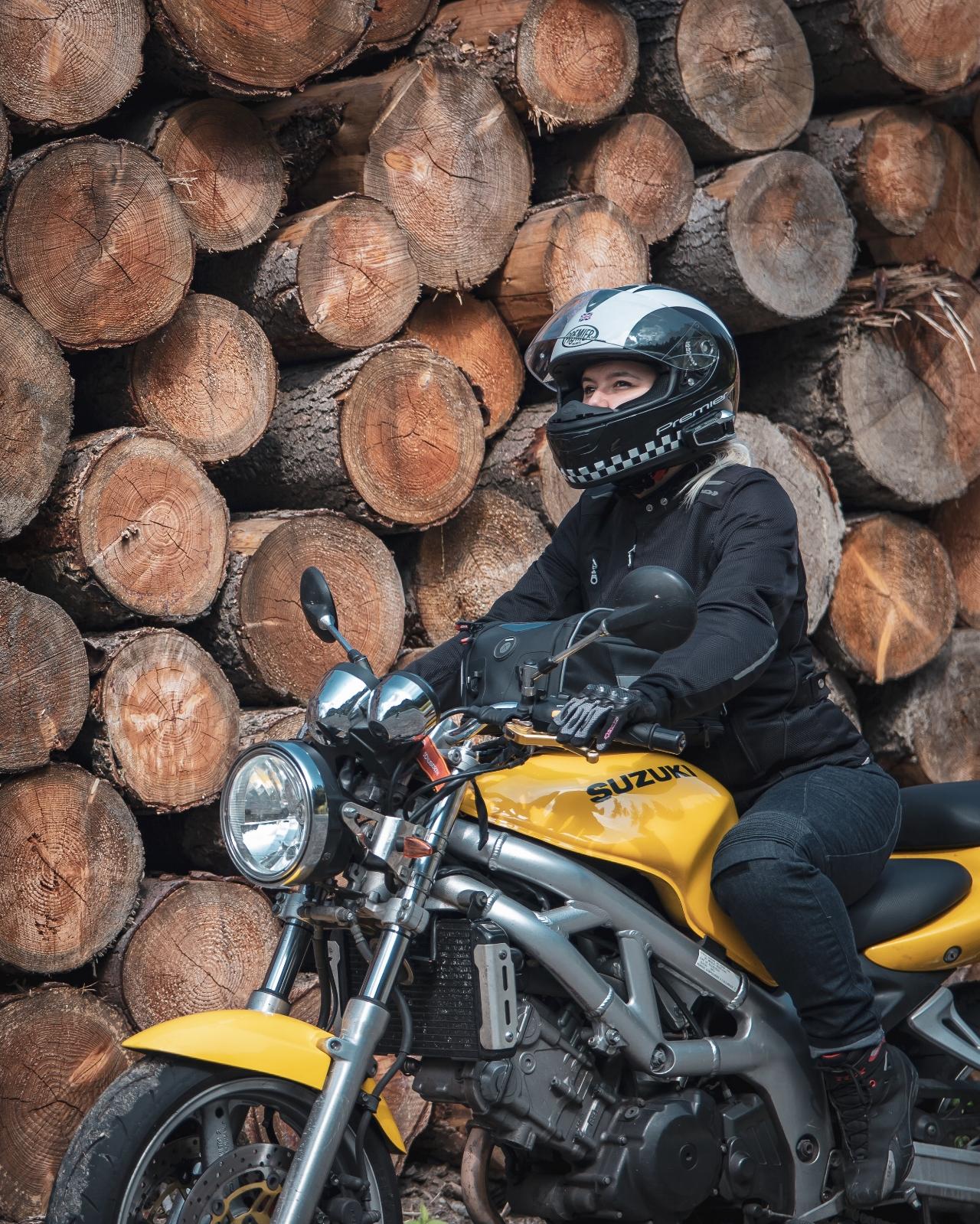 Biker woman on yellow suzuki sv 650
