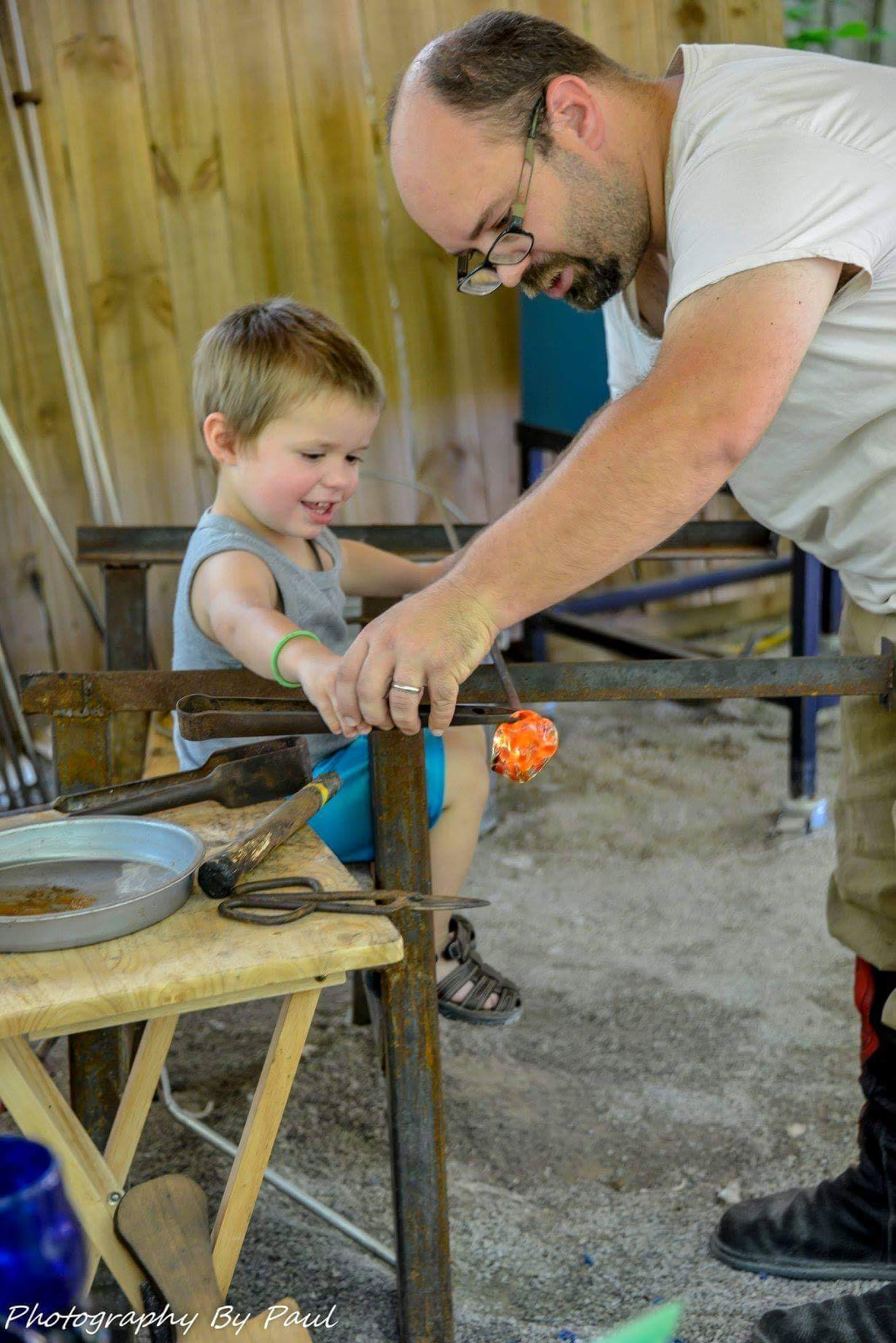 A student making a glass rose in our mobile hot shop