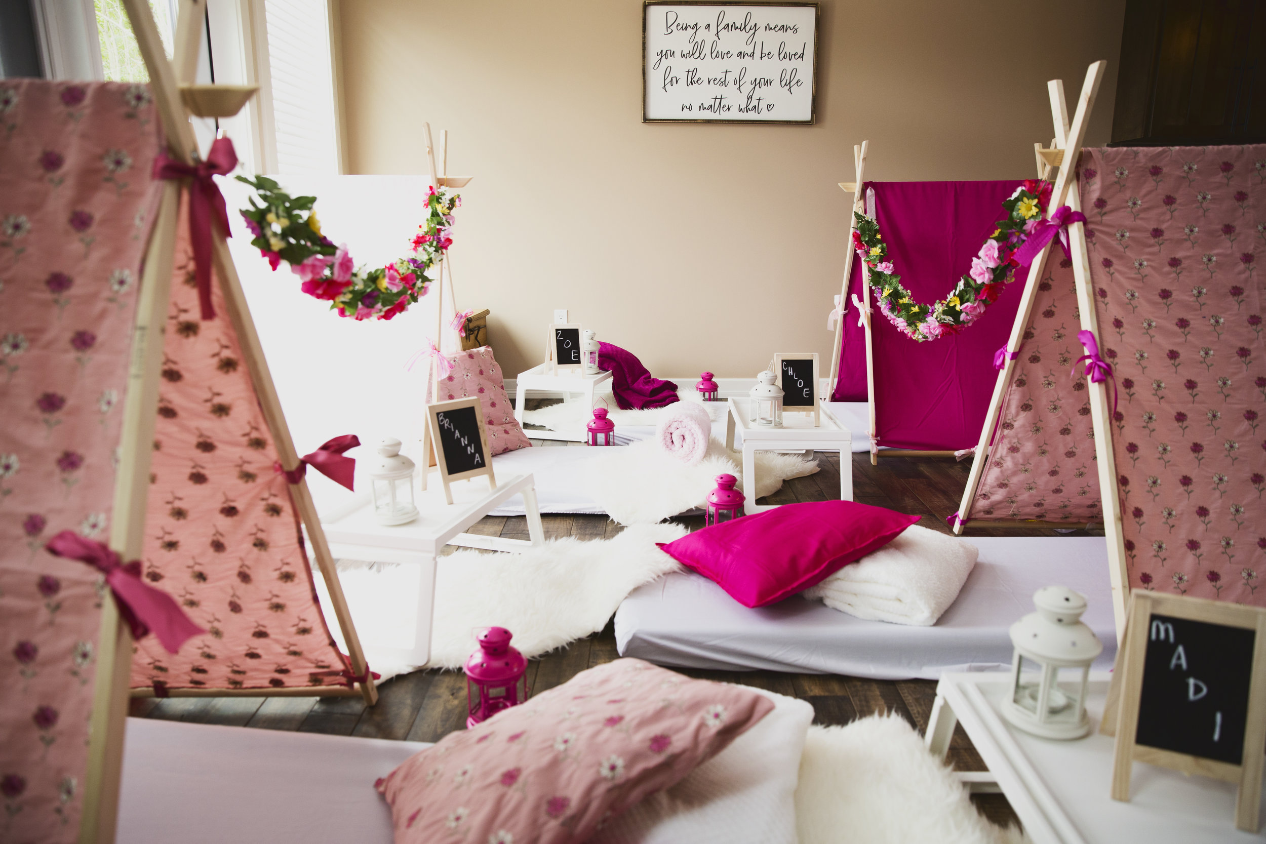 The Enchanted Rose Garden - This style is full of blooming, enchanted roses. We drape flower garlands between the teepees, bringing a modern fairy-tale look to your party. Soft pinks with floral print are intermixed with solid dark pink teepees with garlands to tie this lovely theme together.