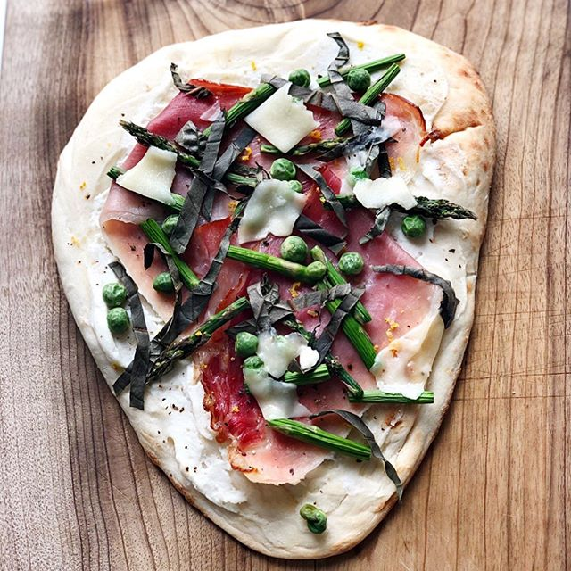 Spring flatbread on the blog tonight: whipped ricotta, salty prosciutto, fresh asparagus and peas with a hint of basil and lemon. You know what goes exceptionally well with this recipe? @gilbertcellars Vin Du Vallee; perfect for #mothersday, perfect for #summernights, perfect for #dinnertonight.