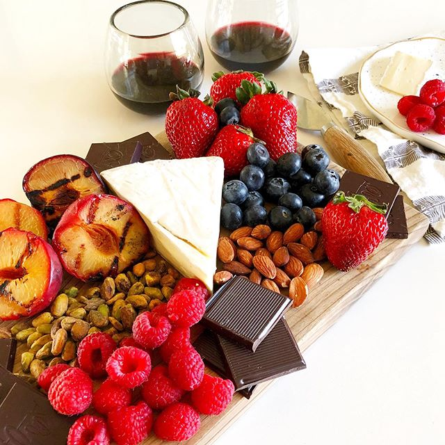 How about a dessert board for #memorialday? A little glass of (@gilbertcellars) wine, gorgeous weather, a few minutes with your people...the perfect day.  This 'recipe' couldn't be easier. Buy what looks good at the store. Arrange on a platter. Pour wine. Enjoy.  If you want to grill some fruit, just cut them in half and remove the pit. Brush the flesh side with melted butter and a small sprinkle of brown sugar. Grill on both sides for 2-3 minutes over medium-low heat.