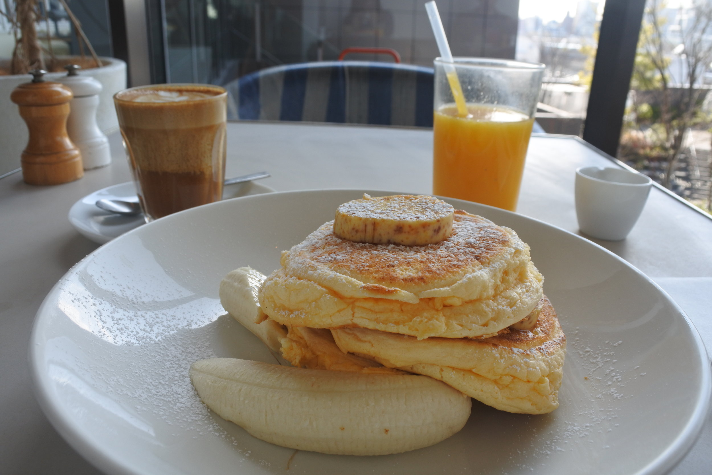 The pancakes were topped with honeycomb butter and fresh bananas.