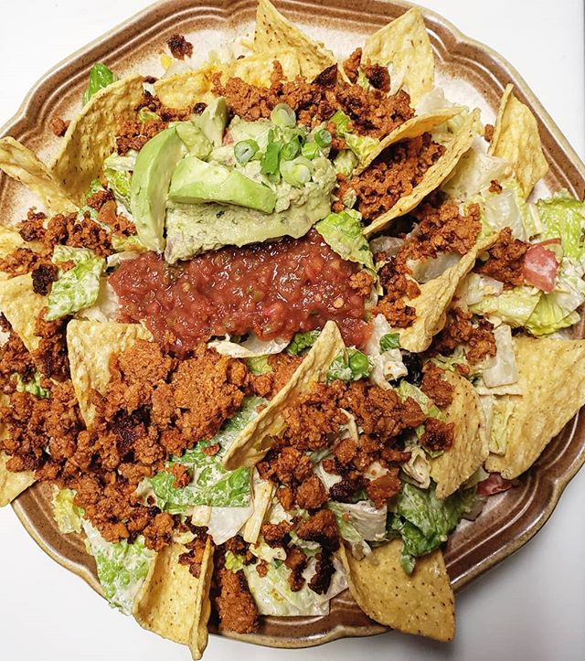 Happy Taco (salad) Tuesday! This bad boy is loaded with corn tortilla chips, lettuce, tomato, red onions, black olives, fresh guacamole, salsa cheddar cheese and our homemade cilantro-lime dressing. Underneath it all lies refried beans and we like to throw chorizo on top because why not ? Come and get it.
