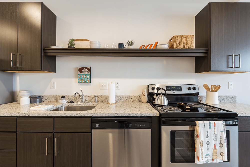 Each apartment is furnished with a Kenmore dishwasher, oven, stove, & refrigerator and espresso wood-look laminate cabinets with granite counters and nickel pulls