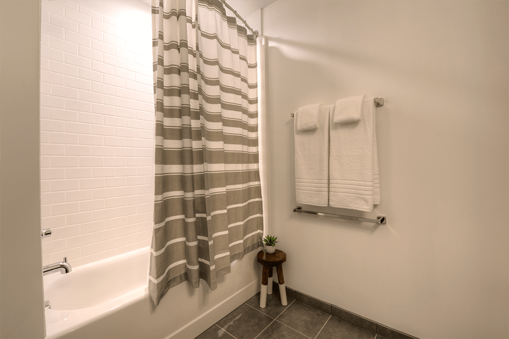 Tubs are surrounded by a white subway tile pattern