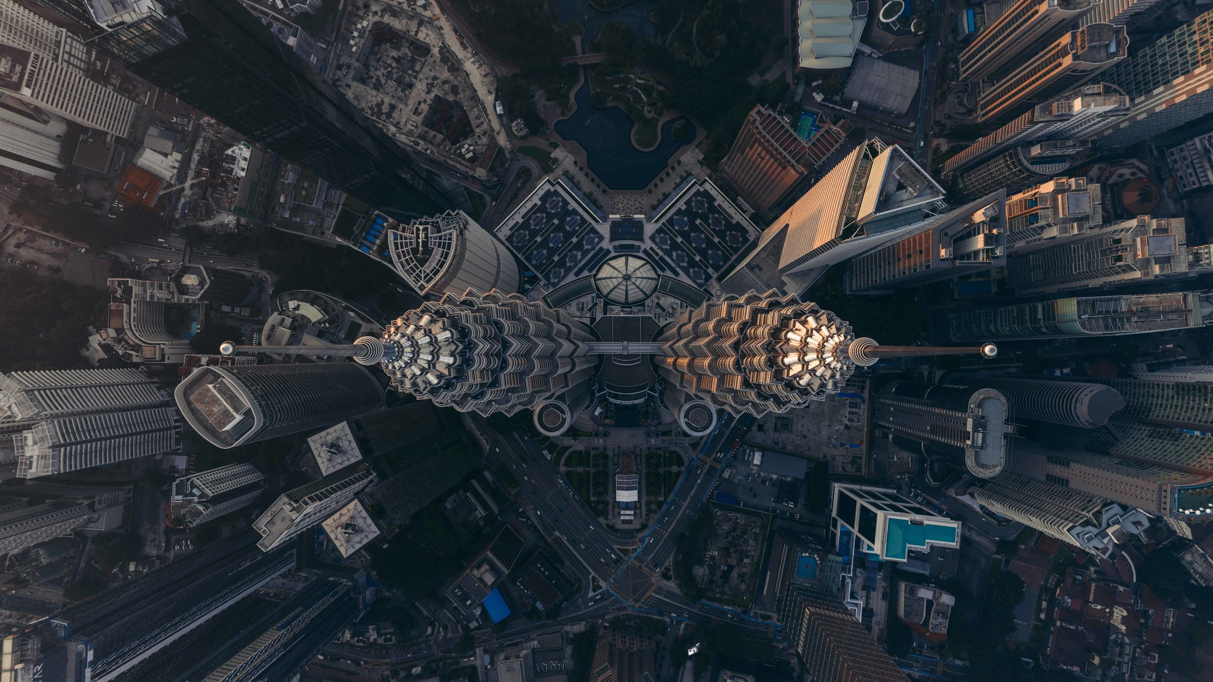 A God's eye view of the Petronas Towers. With only 50 meters of space above, this is probably by risky drone shot!