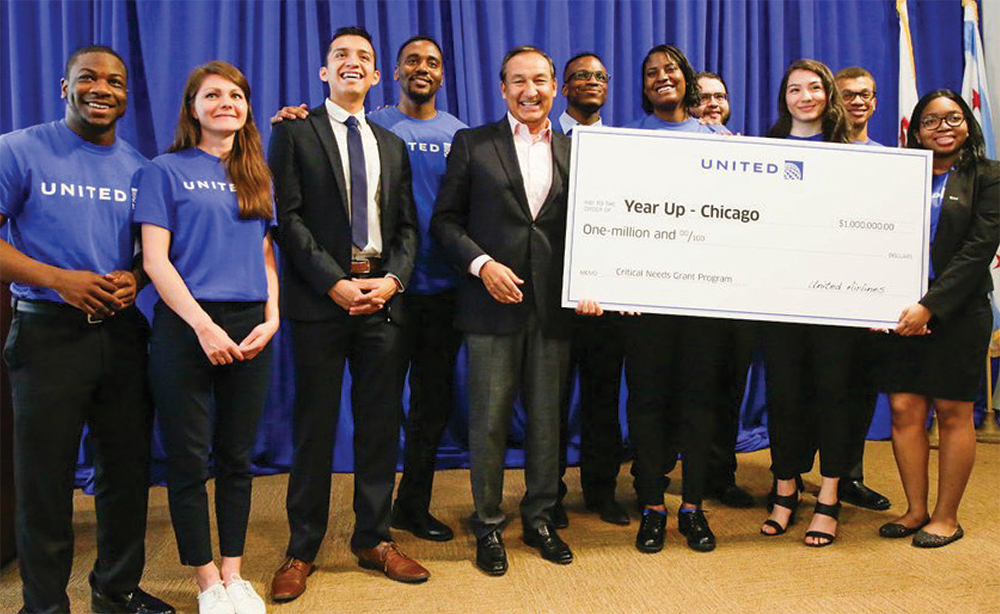 United Airlines CEO Oscar Munoz presents Year Up Chicago with a $1 million grant to further enable the market's growth.