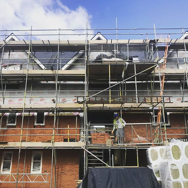 The front of Stratton House Apartments (St. Giles's Hill) . Brick layers are busy. Starting to all come together.